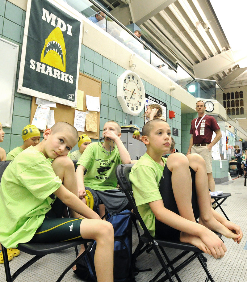 Zeke Valleau, 9, left, and Oliver Johnston, 10, of Mt. Desert Island await their turns Friday during the age-group meet at Bowdoin College. They were part of a winning 400-yard freestyle relay team for boys 10 and under.