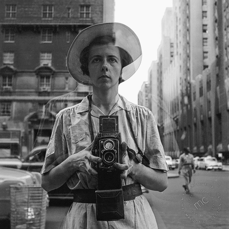 This is an undated and untitled self-portrait of Vivian Maier.