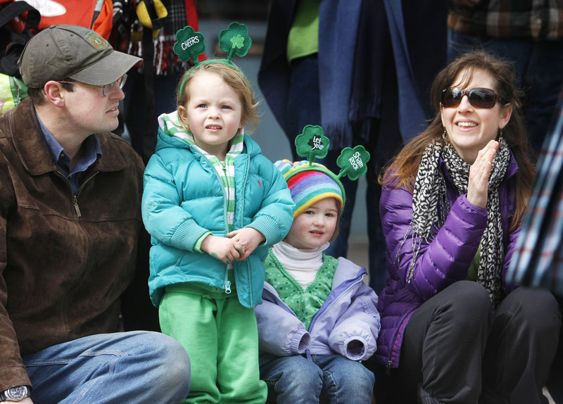 Kate Nicholson, far right, of Bath enjoys the Bath Blarney Days parade with her daughter, Zoe, 3, center, and Zoe's friend Julianna Dunkin.