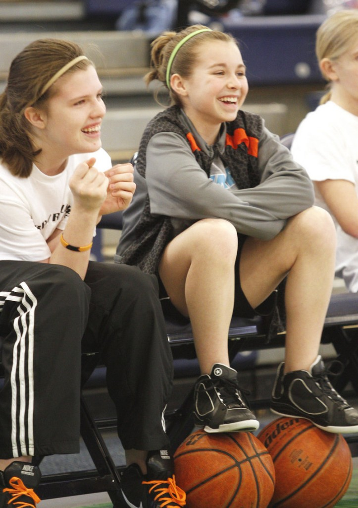 Cassidy Pelletier, left, and Caitlin Paradis, both of Ashland, enjoy watching other players compete while waiting for their turns at the competition.
