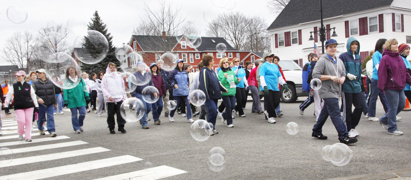 Bubbles blow across Main Street in Saco on Sunday as walkers participate in Mary's Walk to raise money for the Maine Cancer Foundation. The event, which also includes the Kerrymen Pub 5K Road Race for runners, raised $187,660 this year, pushing the 13-year total past $1.6 million.