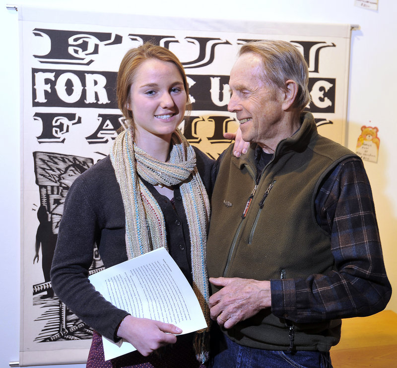 Ali Perkins with her grandfather, Dave Getchell, before reading her winning essay.