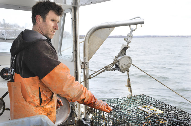 Tom Martin mans his lobster boat, the Lucky Catch, on Monday. Martin is one of 10 local boat owners who participated in a