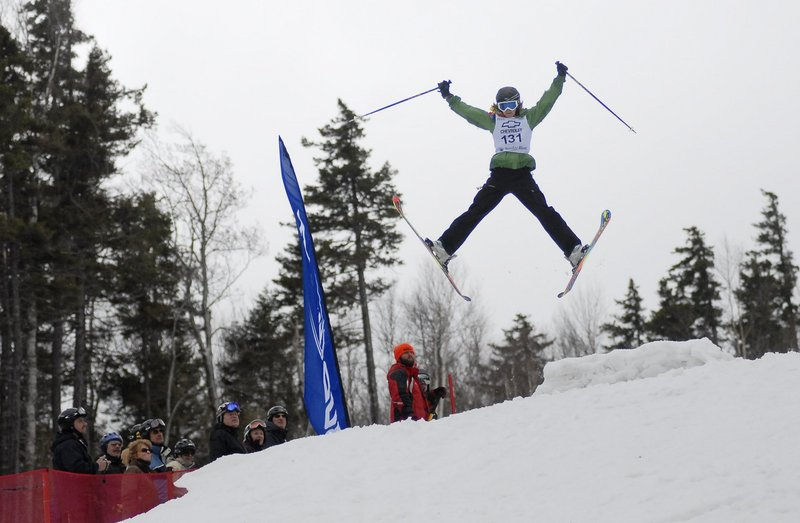 A competitor takes a jump in the Bust and Burn amateur mogul competition during the Parrot Head Festival at Sunday River last year. The ski area's end-of-season festivities run from April 1 to 3 this year.