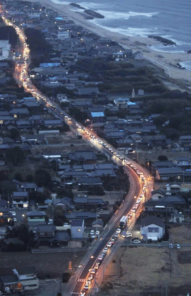 Vehicles driving south out of Fukushima Prefecture, where a troubled nuclear power plant is located, create a miles-long traffic jam in Kitaibaraki, north of Tokyo, on Tuesday.