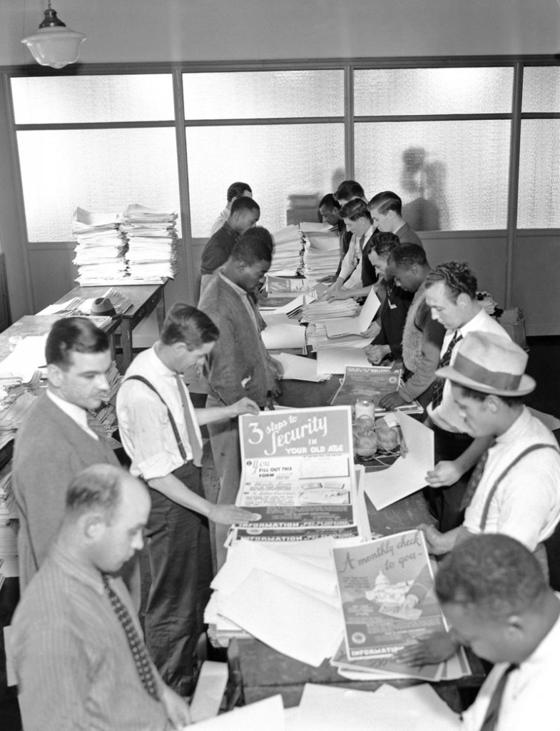 Social Security workers prepare posters for distribution in this undated photo.
