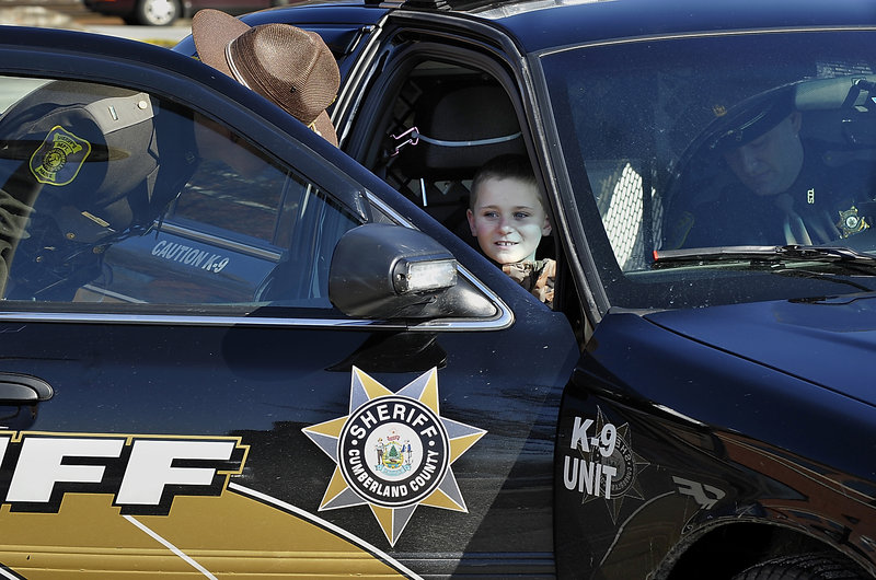 Cameron arrives in a K-9 cruiser to a special reception by the Sheriff's Department in Portland. Cameron hopes to join a police force some day, said his mother, Rhiannon Tufts.