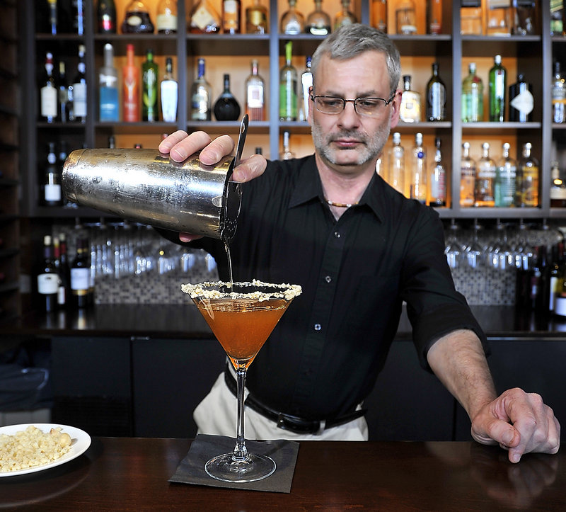 Bar manager Steve Lovenguth at Walter's in Portland pours his Mark of the Maple cocktail.