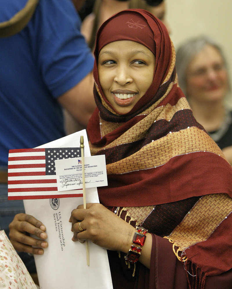 Sadya Roble, who came to the United States from Somalia, smiles after becoming a U.S. citizen Friday at U.S. District Court in Portland.