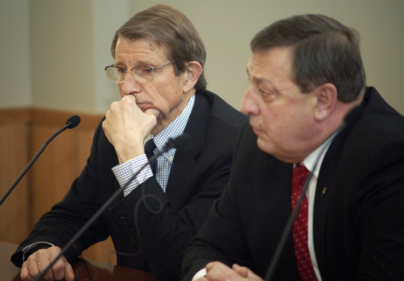 Peter Mills, left, interim executive director of the Maine Turnpike Authority, listens to the MTA's board Friday with Gov. Paul LePage.