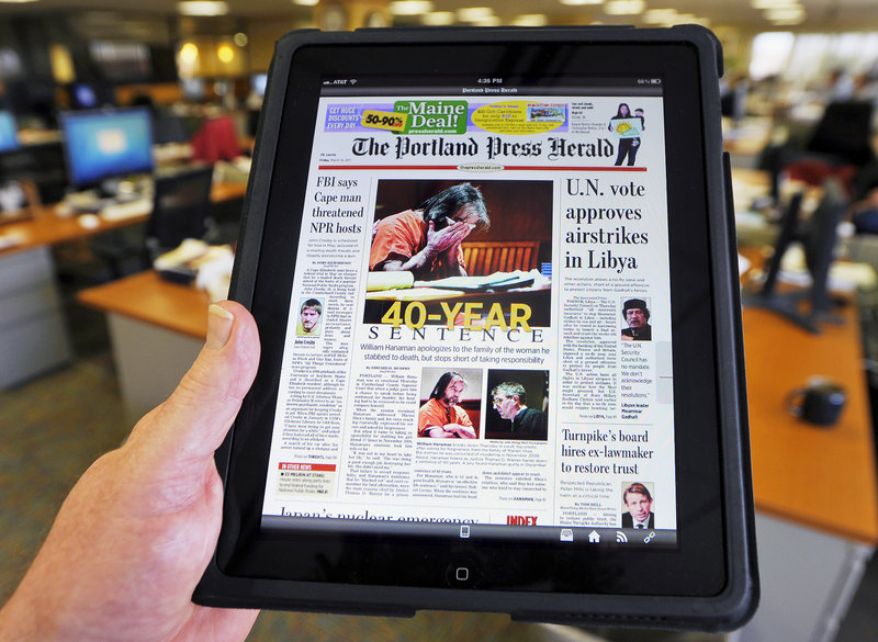 Friday's Portland Press Herald, seen on the new iPad app with the newsroom at One City Center in the background.