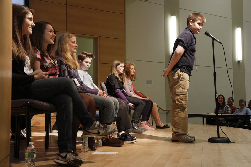 """Medomak Middle School seventh-grader Jackson Vail listens carefully to his word during the Maine State Spelling Bee at University of Southern Maine's Hannaford Hall in Portland on Saturday. He lasted until round 12, when he was stumped by the word """"geoponics."""""""