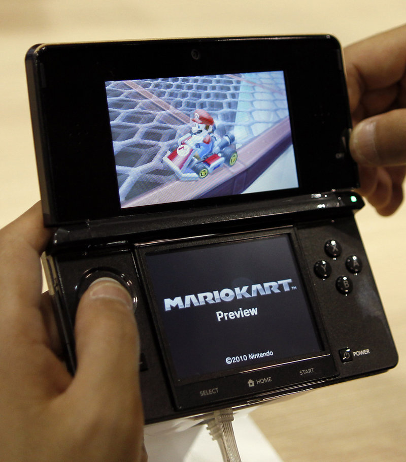 A visitor operates a Nintendo 3DS featuring 3-D imagery. Nintendo Corp. has warned that the 3-D screen on its new 3DS handheld game device shouldn't be used by children 6 or younger because it may harm their immature vision. Optometrists say there's no danger to vision and the device could find undiagnosed problems.