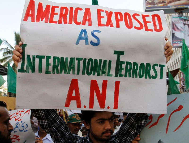 """People rally Friday to condemn CIA contractor Raymond Davis in Karachi, Pakistan. After fatally shooting two Pakistani men, he was released from prison Wednesday following a """"blood money"""" deal with his victims' families."""