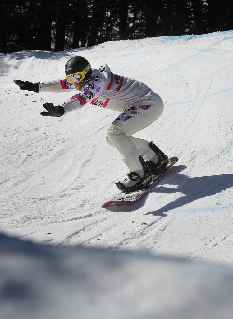 """Jeff Meagher of Carrabassett Valley, wearing an outfit """"circa 1986,"""" keeps his balance while coming out of a turn on his first run."""