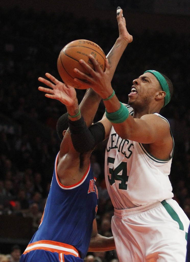 Paul Pierce shoots around New York's Shawne Williams on Monday. Pierce hit 8 of 13 shots against the Knicks as he scored 21 points during the Celtics' 96-86 win.