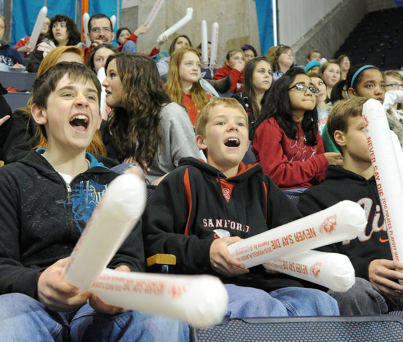 Sanford Junior High students Matt Webber, 12, left, and Peter Hegarty, 13, whoop it up for the Pirates.