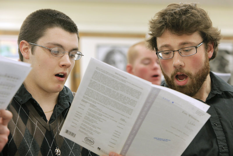Kennebunk High senior Michael Thyng, left, and USM senior Joshua Miller sing during a workshop Wednesday. USM students also performed for local school choruses.