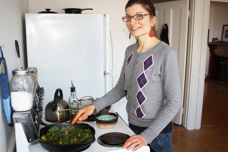 Food blogger Lauren Montanaro Norster stirs a curry in her Portland kitchen.