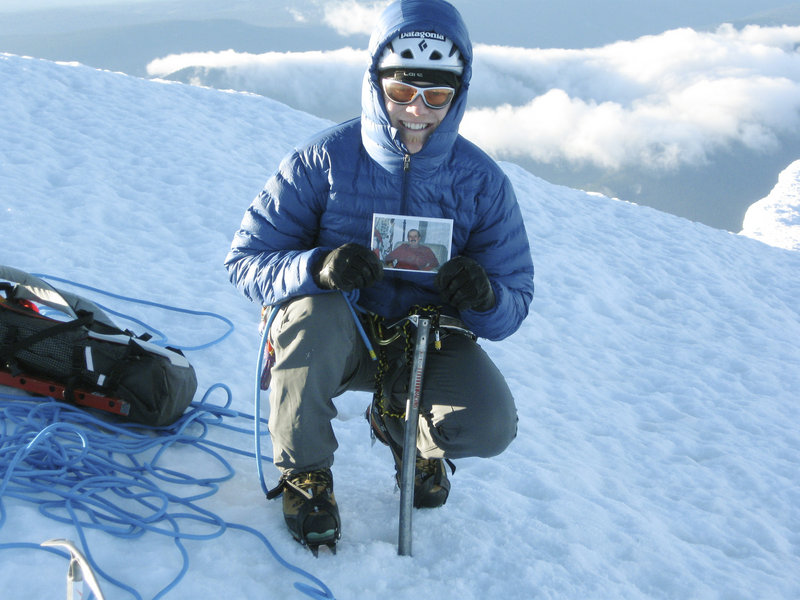 "Pat Connolly displays a picture of his late uncle, ""Rockin'"" Rod Scribner, at the summit of Mount Hood during last year's Climb for Cancer Care. Connolly organizes the annual climbs to raise money for amenities for cancer patients in Maine Medical Center's Gibson Pavilion."