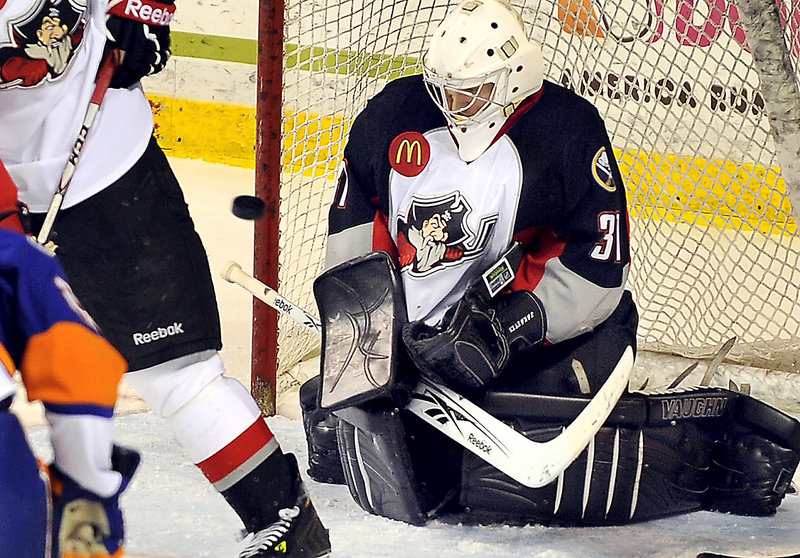 Pirates goalie Jeff Jakaitis drops to his pads to make a save in the first period of Friday night's game against the Sound Tigers at the Cumberland County Civic Center. Jakaitis made his third start with Portland.