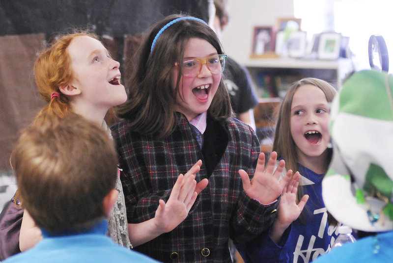 As judges look on, students from the Breakwater School in Portland perform a short play as part of a challenge called Le Tour Guide at the Odyssey of the Mind state tournament on Saturday at Sanford High School. They are, from left, Arianna Coan-Prichard, Dora Chaison-Lapine and Tova Kemmerer.