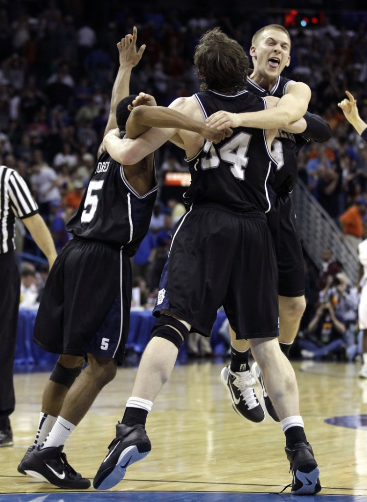 Zach Hahn celebrates Saturday with Matt Howard, 54, and Ronald Nored, left, after Butler earned a second consecutive appearance in the Final Four with a 74-71 overtime victory against Florida.