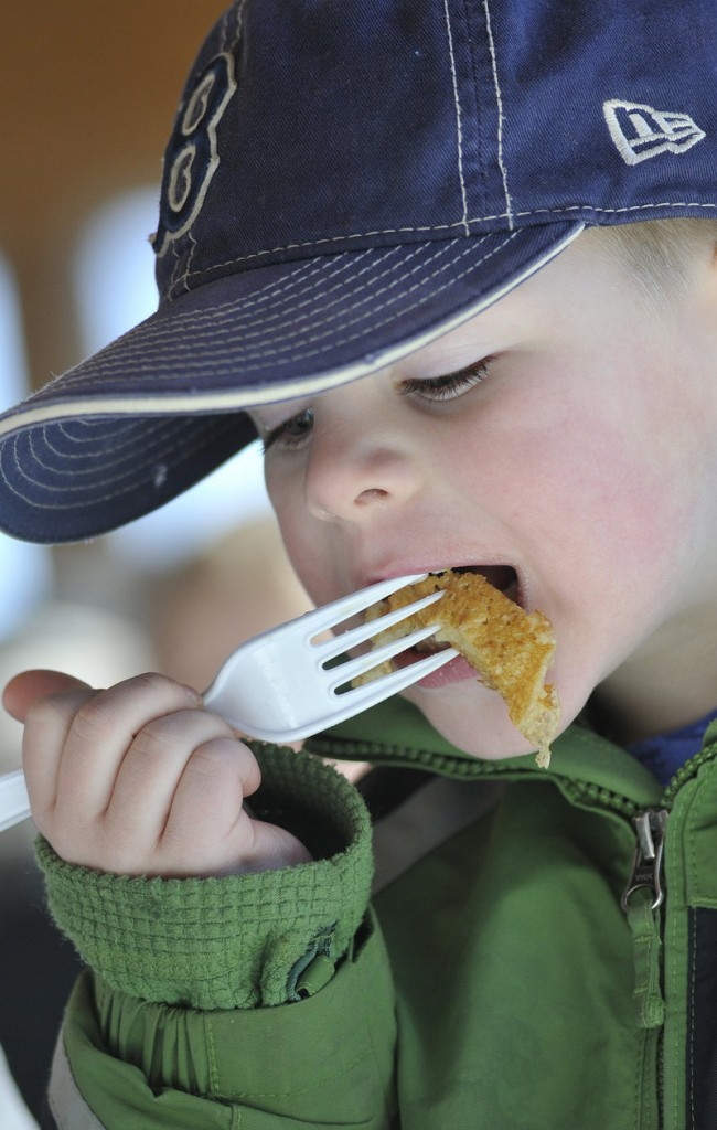Balin Pelletier, 5, of Saco enjoys the taste of Maine Maple Sunday at Harris Farm.