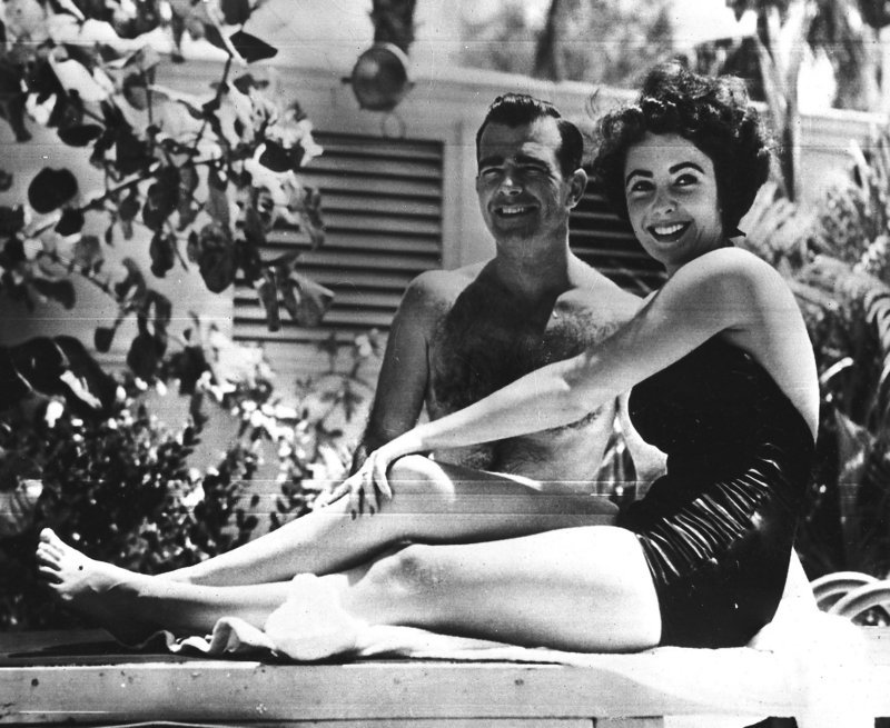 A 17-year-old Elizabeth Taylor poses in June 1949 with fiance William D. Pawley Jr. at his father's home in Miami Beach, Fla. More than 60 love letters written by the actress, who died last week at age 79, will be put up for auction by RR Auction in Amherst, N.H.