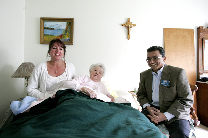Reynolds Corea, right, and caregiver Janice Campbell, left, visit client Rosamond Murphy in Downingtown, Pa. Corea, an outsourcing expert laid off from Accenture after nearly 20 years, has started a BrightStar home-health-care franchise. Corea likes the structure that is provided by a franchise.