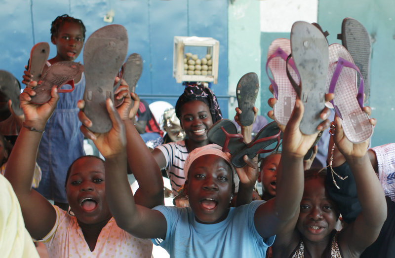 Supporters of Alassane Ouattara raise their shoes, symbolizing the placing of a curse on incumbent leader Laurent Gbagbo, after participating in a special Muslim prayer in honor of the civilians killed in three months of post-election violence, at a mosque in Abidjan, Ivory Coast, on Friday.