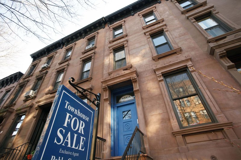 A townhouse for sale in Brooklyn, N.Y. Housing prices fell in 19 of 20 large cities and 0.22 percent overall in January, according to the S&P/Case-Shiller index released Tueday. Washington was the only city in which prices rose.