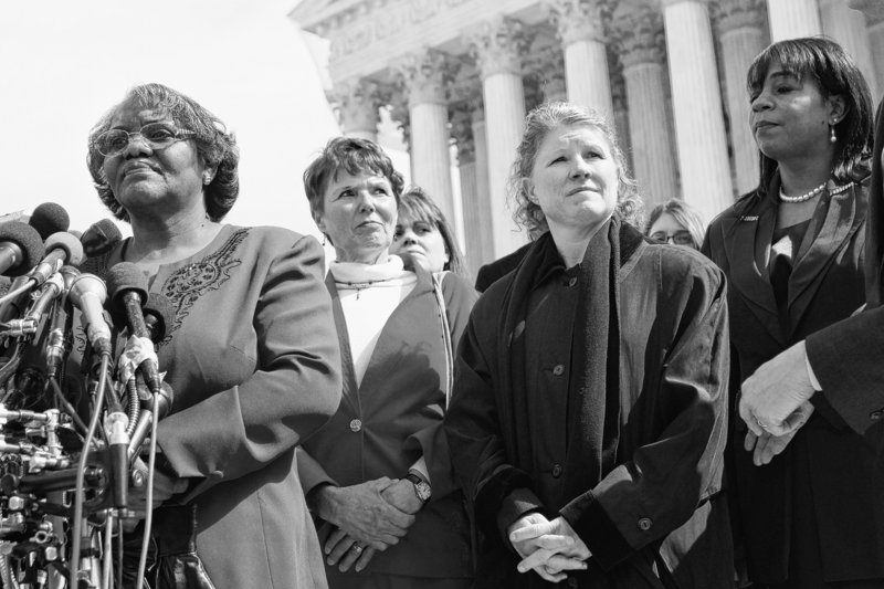 Plaintiffs in a case of women employees against Walmart, from left, Betty Dukes, of Pittsburg, Calif., Deborah Gunter, of Palm Springs, Calif., Christine Kwapnoski, of Bay Point, Calif., and Edith Arena, of Duarte, Calif., take part in a news conference Tuesday outside the Supreme Court in Washington.