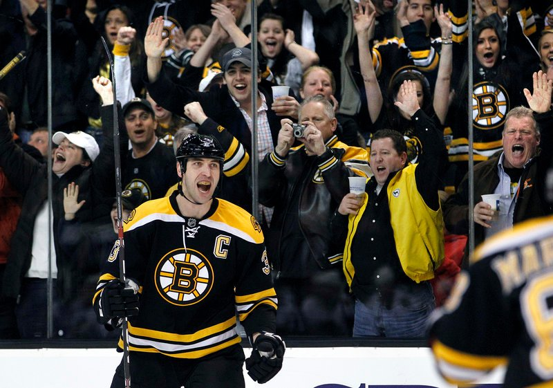 As the Bruins' fans cheer Tuesday night, defenseman Zdeno Chara turns to his teammates after scoring against the Chicago Blackhawks in the second period of a 3-0 victory.