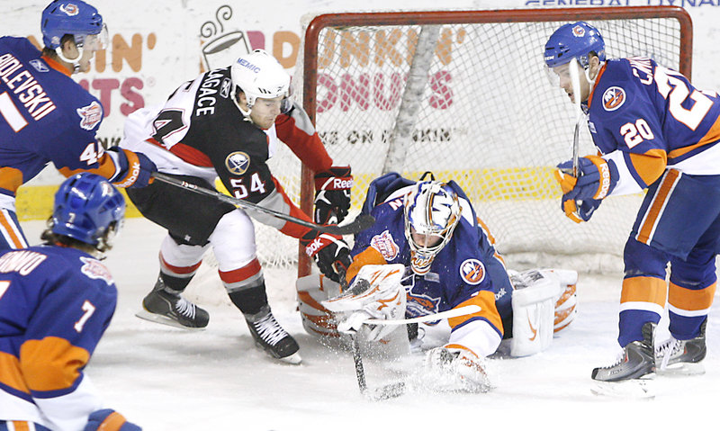 Jacob Lagace of the Pirates gets inside the Bridgeport defense and tries to stuff the puck past goalie Mikko Koskinen in the Sound Tigers' 2-1 win Wednesday night.