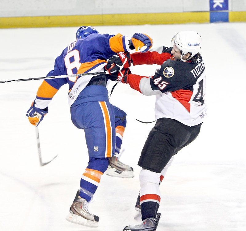 Nick Tuzzolino, right, of the Pirates knocks down Brian Day of the Sound Tigers during Wednesday night's game. Bridgeport beat Portland for the second time in six nights.
