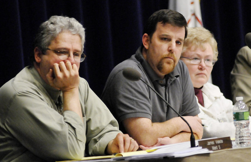 School Finance Committee members Jim Violette, left, Alex Stone and Mary Hall listen to comments at a public meeting on the Westbrook school budget Wednesday at the Performing Arts Center.