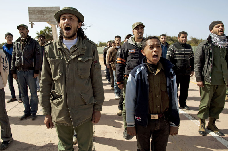 Training sessions for hundreds of young men who want to overthrow Libyan ruler Moammar Gadhafi often include young boys. The rebels come daily to Benghazi's seized army base for lessons in shooting rifles, loading rocket launchers and firing artillery shells. They express different visions for Libya's future.