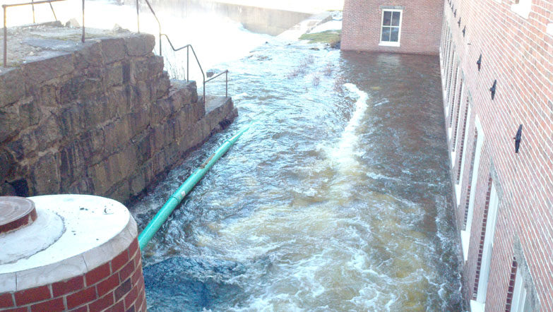 Photos provided by the Biddeford Department of Code Enforcement & Emergency Management show flooding today at the Saco Mill by the Falls apartment complex.