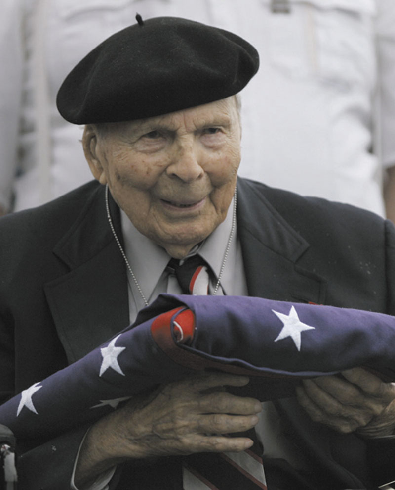 In a May 26, 2008, file photo Frank Buckles receives an American flag during Memorial Day activities at the National World War I Museum in Kansas City, Mo.
