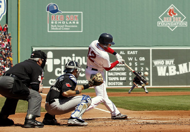 Boston's Jed Lowrie connects on a two-run single during a game against the Blue Jays at Fenway on Monday.