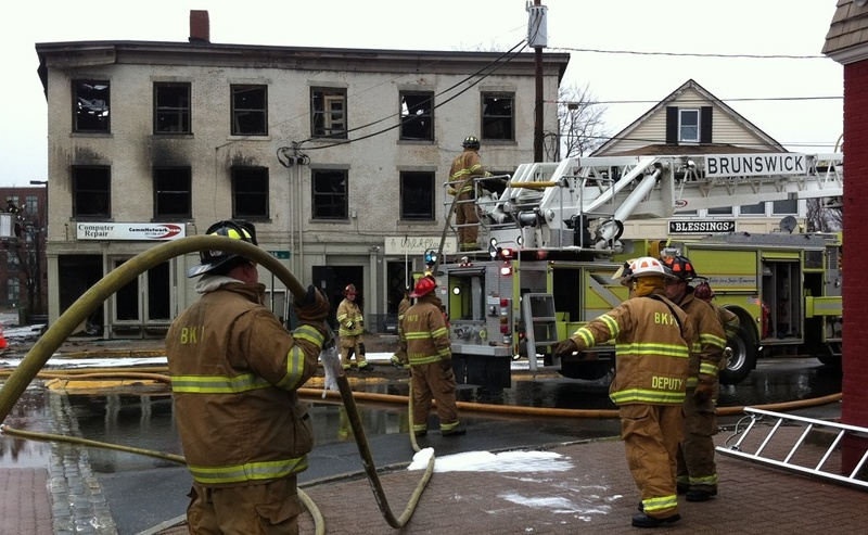 A three-alarm fire at 45 Maine St. in Brunswick destroyed apartments, a bakery and other businesses.