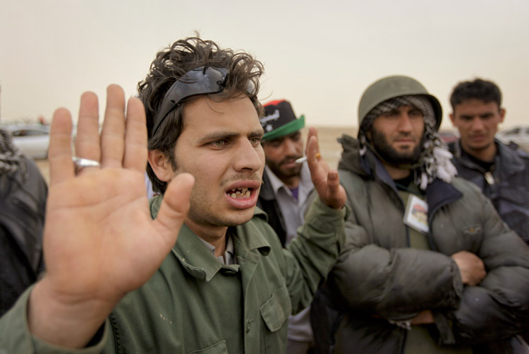 A Libyan rebel fighter expresses anger today on hearing from other rebels that a NATO airstrike farther up the road toward Brega had hit rebel forces, killing at least two and injuring more than a dozen.
