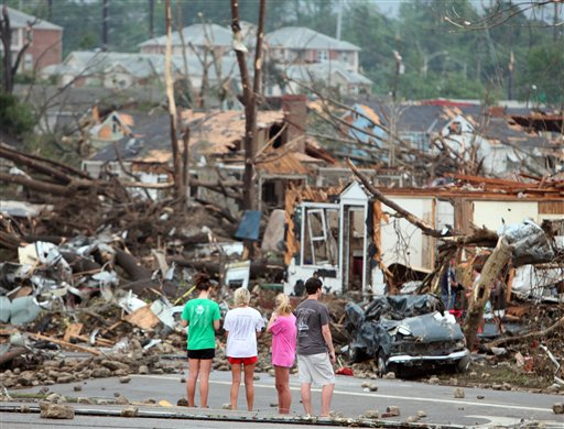 Bystanders look on at storm damage along 15th Street in Tuscaloosa, Ala., Wednesday, April 27, 2011. A strong tornado moved through the city Wednesday afternoon. (AP Photo/The Tuscaloosa News, Dusty Compton) storm