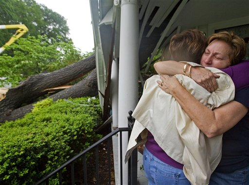 Mae Woody Christopher is comforted by a friend after a large oak tree split and crashed into her 7th Street home, Wednesday, April 27, 2011 in Tuscumbia, Ala. (AP Photo/TimesDaily,Daniel Giles)