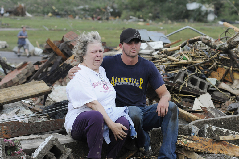 Judy Cook, who lost her home, is comforted by Chase Spradlin in Concord, Ala., Wednesday.