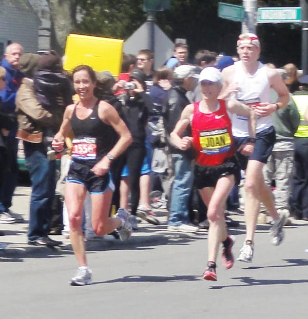 "Former Falmouth resident Kara Waters runs alongside Joan Benoit Samuelson at the Boston Marathon on Monday. Waters, who now lives in Baltimore, said a friend took the photo at mile 17. ""I was so thrilled to see her,"" said Waters, who remembers attending one of Benoit's running camps as a 7th grader. ""She smiled and said, 'You are doing such a great time. Go get it.' Needless to say, she passed me at mile 18, but what an inspiration!"" Happy to share more and kind of a once in a life-time photo op considering she hasn't run the marathon in years and heard there were a number of news segments about her running the marathon this year."