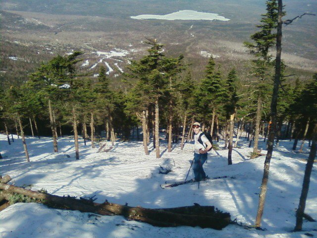 Josh Christie skies in Saddleback's Casablanca Glade last April. One of the pleasures of spring skiing is being able to shed winter parkas.