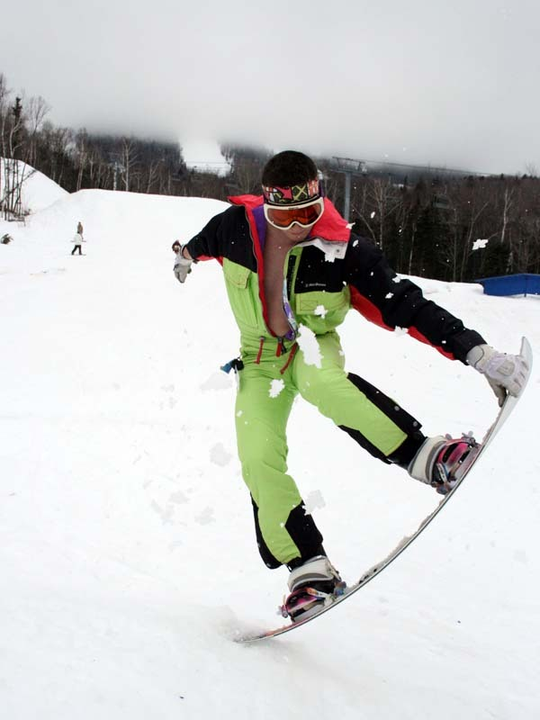 Ryan Lilly celebrates spring at Sugarloaf. Lilly and other snowboarders and skiers say the end of the season brings out the daredevil in them.