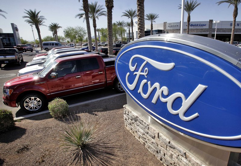 New Ford vehicles are shown at a dealership in Glbert, Ariz. Consumer demand for more fuel-efficient vehicles continues to grow.